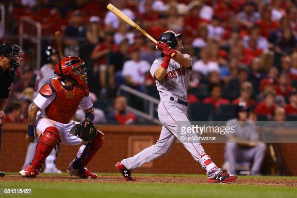 Andrew Benintendi of the Boston Red Sox hits a sacrifice knocking in a run against the St Louis Cardinals in the eighth inning at Busch Stadium on...