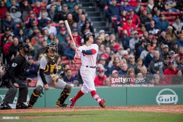 Andrew Benintendi of the Boston Red Sox hits a single against the Pittsburgh Pirates in the eighth inning at Fenway Park on April 13 2017 in Boston...
