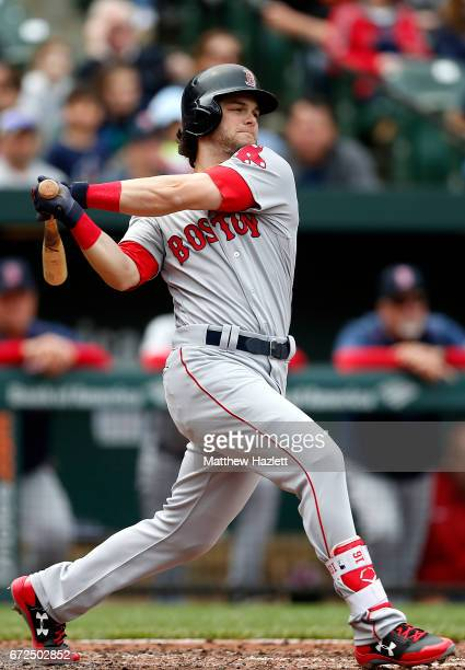 Andrew Benintendi of the Boston Red Sox hits a single against the Baltimore Orioles in the second inning at Oriole Park at Camden Yards on April 23...