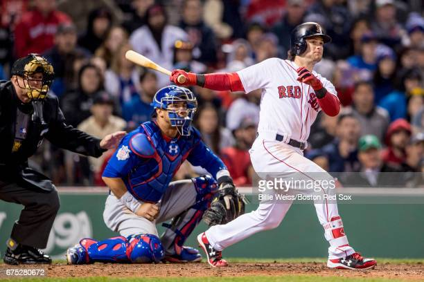 Andrew Benintendi of the Boston Red Sox hits a single during the eighth inning of a game against the Chicago Cubs on April 30 2017 at Fenway Park in...