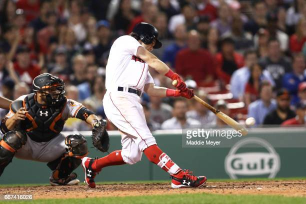 Andrew Benintendi of the Boston Red Sox hits a single during the seventh inning against the Baltimore Orioles at Fenway Park on April 11 2017 in...