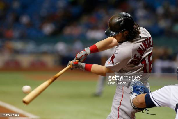 Andrew Benintendi of the Boston Red Sox hits a single off of pitcher Jake Odorizzi of the Tampa Bay Rays during the first inning of a game on August...
