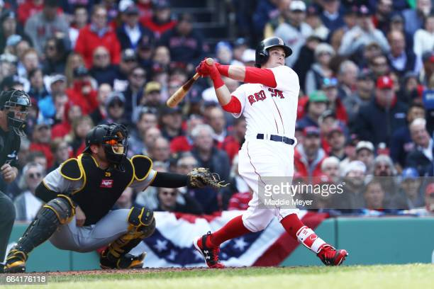 Andrew Benintendi of the Boston Red Sox hits a three run home run during the fifth inning of the opening day game against the Pittsburgh Pirates at...