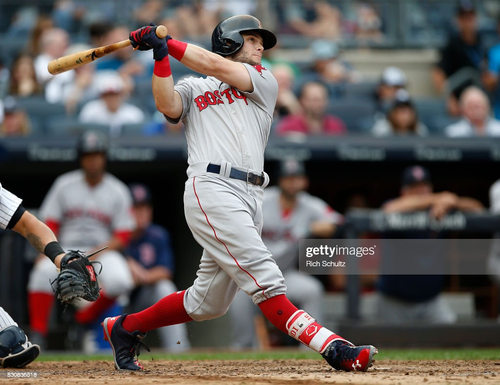 Andrew Benintendi #16 of the Boston Red Sox hits a three-run home run against the New York Yankees during the fifth inning of a game at Yankee Stadium on August 12, 2017 in the Bronx borough of New York City.