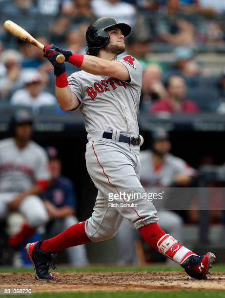 Andrew Benintendi of the Boston Red Sox hits a threerun home run against the New York Yankees during the fifth inning of a game at Yankee Stadium on...
