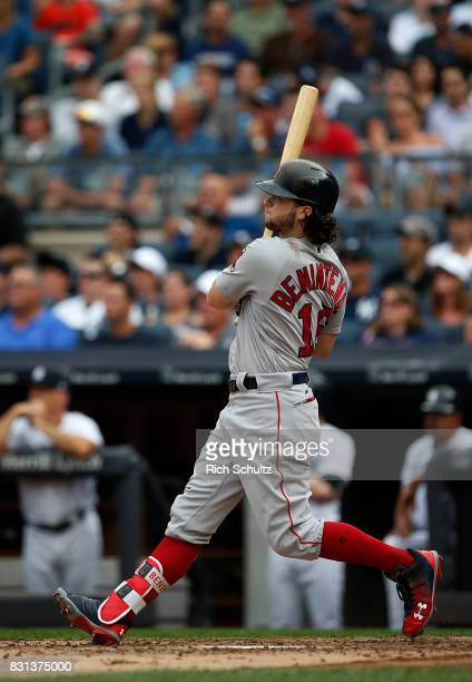 Andrew Benintendi of the Boston Red Sox hits a threerun home run against the New York Yankees during the third inning of a game at Yankee Stadium on...