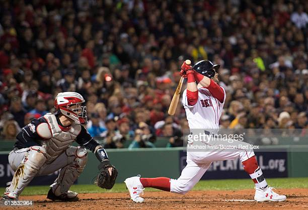 Andrew Benintendi of the Boston Red Sox hits an RBI double against the Cleveland Indians in the fifth inning of game three of the American League...