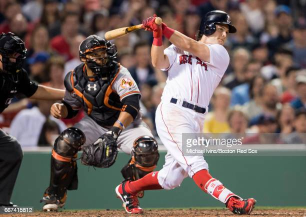 Andrew Benintendi of the Boston Red Sox hits an RBI double against the Baltimore Orioles in the seventh inning at Fenway Park on April 11 2017 in...