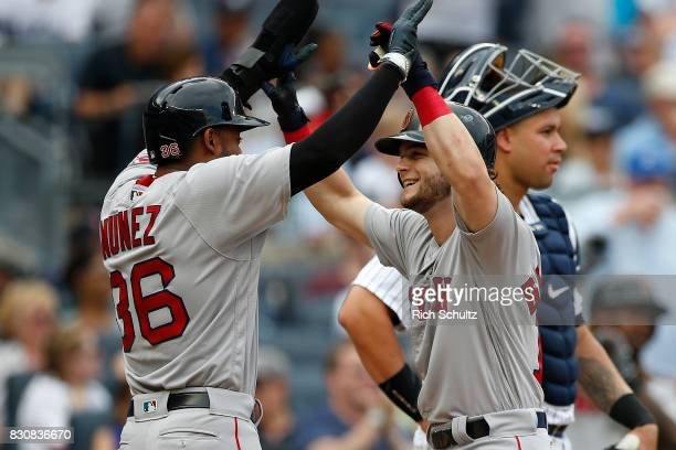 Andrew Benintendi of the Boston Red Sox is congratulated by Eduardo Nunez after he hit a threerun home run against the New York Yankees during the...