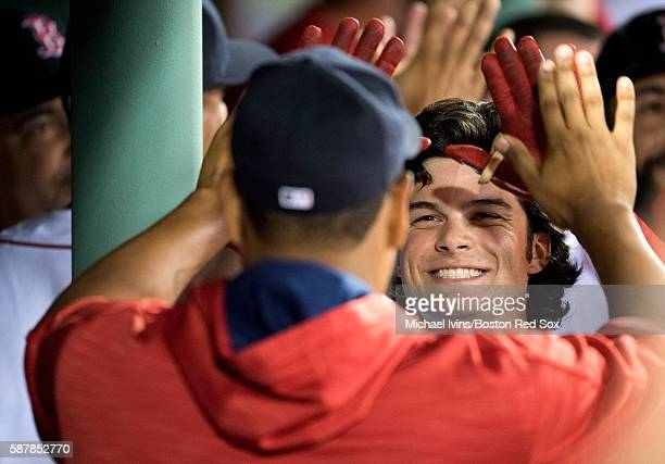 Andrew Benintendi of the Boston Red Sox is congratulated in the dugout after hitting an apearant tworun home run against the New York Yankees in the...