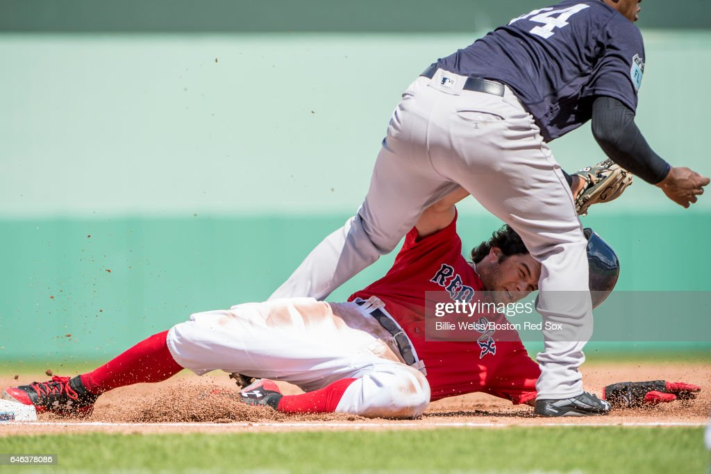 Andrew Benintendi #16 of the Boston Red Sox is tagged out as he attempts to steal third base during the first inning of a Spring Training game against the New York Yankees on February 28, 2017 at Fenway South in Fort Myers, Florida .