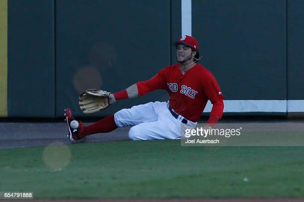 Andrew Benintendi of the Boston Red Sox is unable to catch the ball hit by Adam Frazier of the Pittsburgh Pirates in the first inning during a spring...