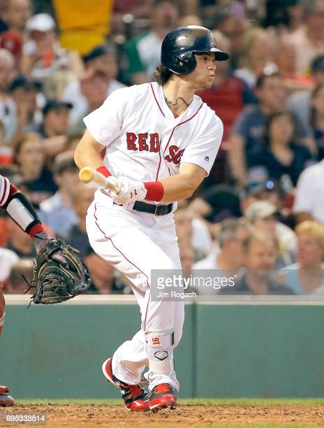 Andrew Benintendi of the Boston Red Sox knocks in a run against the Philadelphia Phillies in the third inning at Fenway Park on June 12 2017 in...