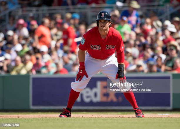 Andrew Benintendi of the Boston Red Sox leads off from first base during a spring training game against the New York Mets on February 24 2017 at...