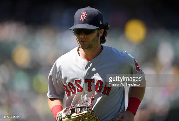 Andrew Benintendi of the Boston Red Sox looks on as he jogs off the field at the end of the seventh inning against the Oakland Athletics at Oakland...