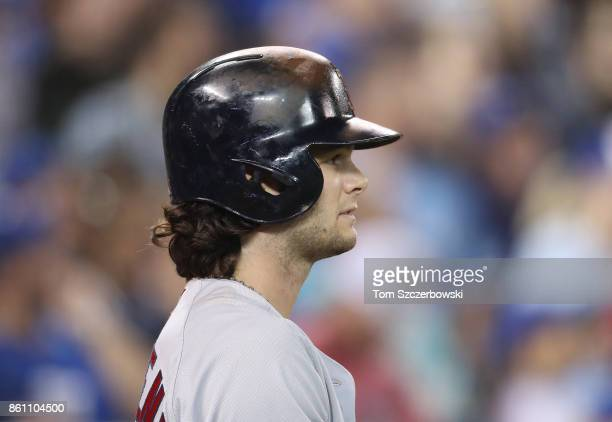 Andrew Benintendi of the Boston Red Sox looks on from the ondeck circle as he prepares to bat in the eighth inning during MLB game action against the...