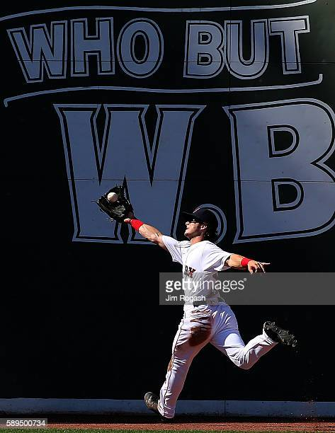 Andrew Benintendi of the Boston Red Sox makes a running catch against the Arizona Diamondbacks in the seventh inning at Fenway Park on August 14 2016...