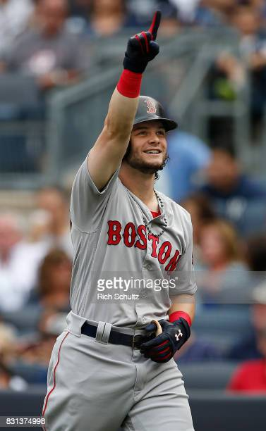 Andrew Benintendi of the Boston Red Sox reacts after hitting a three home run against the New York Yankees during the third inning of a game at...