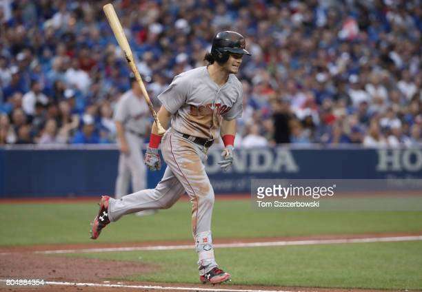 Andrew Benintendi of the Boston Red Sox reacts as he pops out in the fifth inning during MLB game action against the Toronto Blue Jays at Rogers...