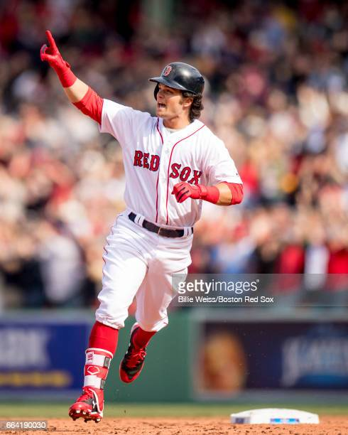 Andrew Benintendi of the Boston Red Sox reacts as he rounds the bases after hitting a three run home run during the fifth inning of the home opener...
