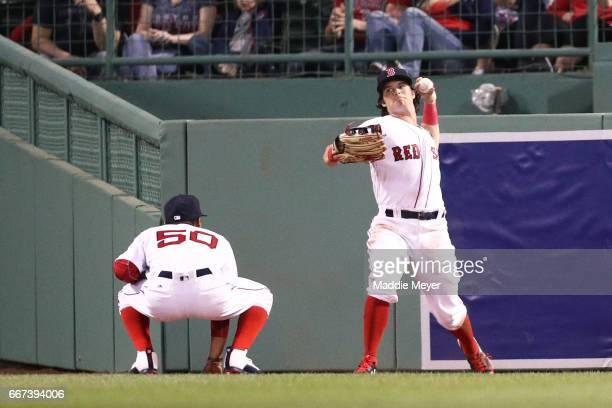 Andrew Benintendi of the Boston Red Sox returns a double hit by Trey Mancini of the Baltimore Orioles during the second inning at Fenway Park on...
