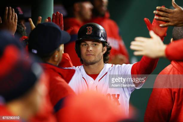 Andrew Benintendi of the Boston Red sox returns to the dugout after scoring in the eighth inning of a game against the Chicago Cubs at Fenway Park on...