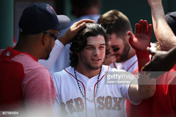 Andrew Benintendi of the Boston Red Sox returns to the dugout after scoring in the third inning of a game against the Chicago White Sox at Fenway...