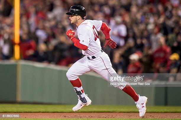 Andrew Benintendi of the Boston Red Sox rounds first base after hitting an RBI double during the fifth inning of game three of the American League...