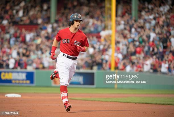 Andrew Benintendi of the Boston Red Sox rounds the bases after a home run against the Chicago Cubs in the first inning at Fenway Park on April 28...