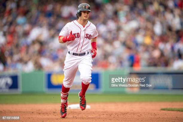 Andrew Benintendi of the Boston Red Sox rounds the bases after hitting a solo home run during the fifth inning of a game against the Chicago Cubs on...