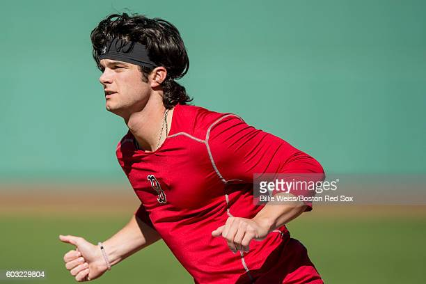 Andrew Benintendi of the Boston Red Sox runs sprints before a game against the Baltimore Orioles on September 12 2016 at Fenway Park in Boston...