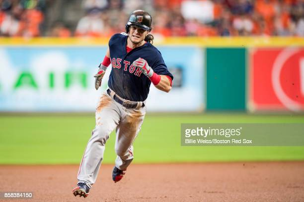 Andrew Benintendi of the Boston Red Sox runs to third base during the first inning of game two of the American League Division Series against the...