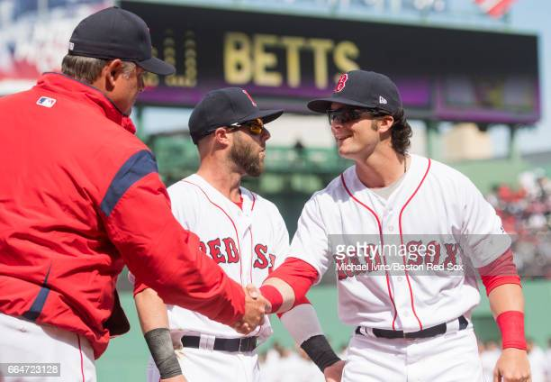 Andrew Benintendi of the Boston Red Sox shakes hands with manager John Farrell during team introductions before an opening day game against the...
