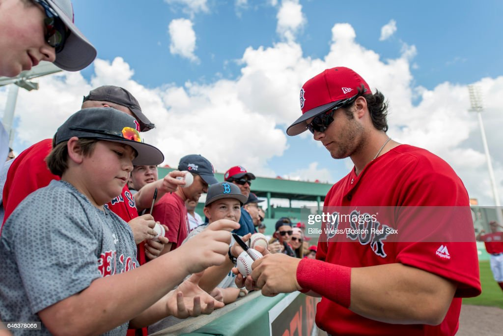 Andrew Benintendi #16 of the Boston Red Sox signs autographs before a Spring Training game against the New York Yankees on February 28, 2017 at Fenway South in Fort Myers, Florida .