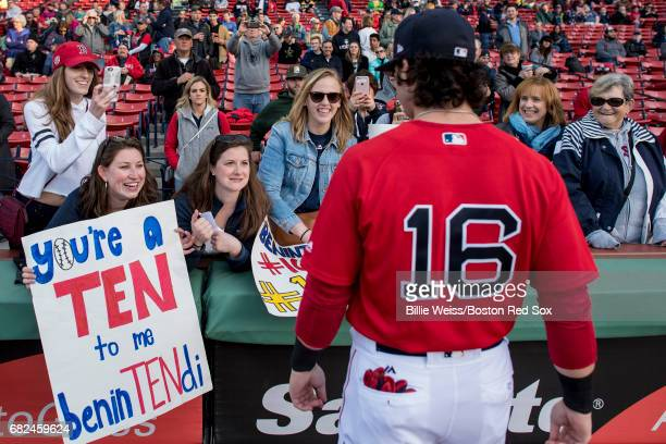 Andrew Benintendi of the Boston Red Sox signs autographs for fans before a game against the Tampa Bay Rays on May 12 2017 at Fenway Park in Boston...