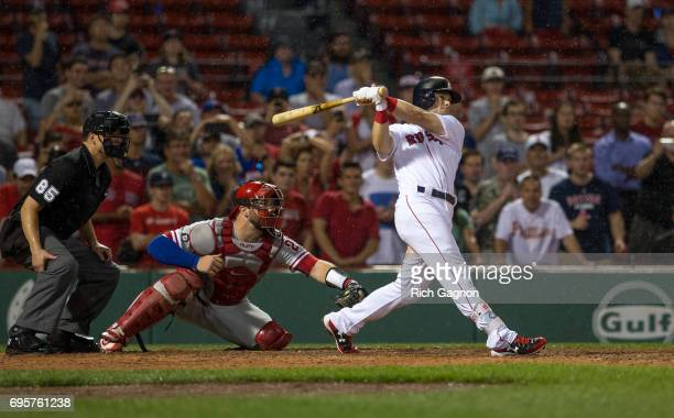 Andrew Benintendi of the Boston Red Sox singles to drive in teammate Xander Bogaerts for the winning run during the twelfth inning against the...