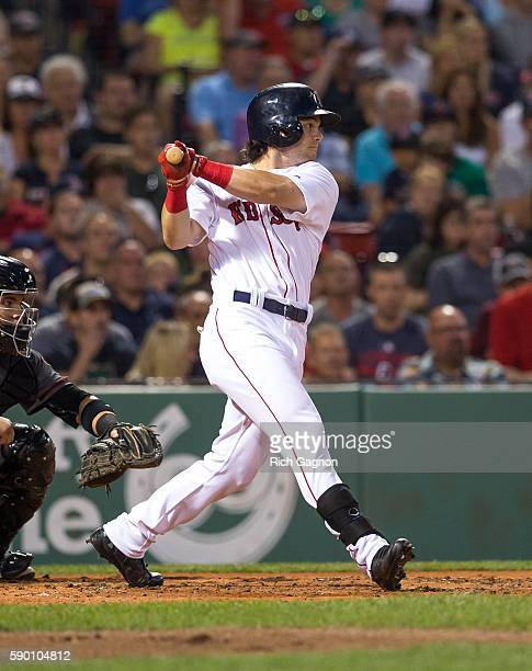 Andrew Benintendi of the Boston Red Sox singles to left field during the third inning at Fenway Park on August 13 2016 in Boston Massachusetts The...
