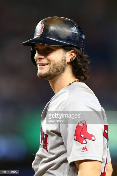 Andrew Benintendi of the Boston Red Sox smiles after hitting a RBI single in the tenth inning against the New York Yankees at Yankee Stadium on...