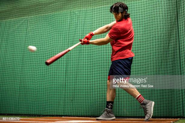 Andrew Benintendi of the Boston Red Sox takes batting practice in the cage before a game against the Cleveland Indians on August 14 2017 at Fenway...