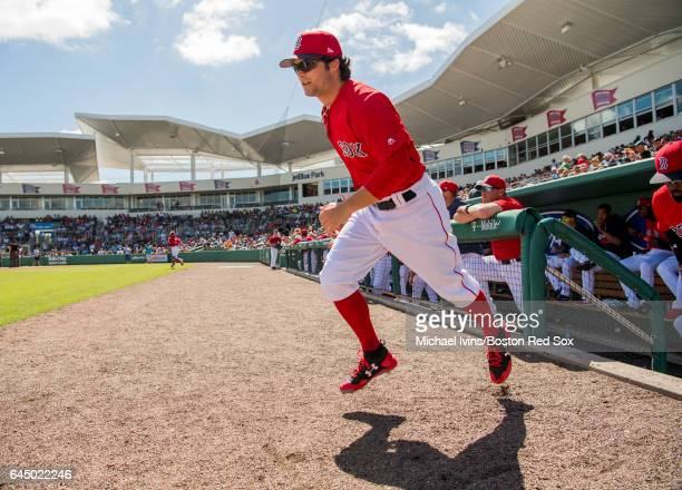 Andrew Benintendi of the Boston Red Sox takes takes a field for a game against the New York Mets on February 24 2017 at jetBlue Park in Fort Myers...