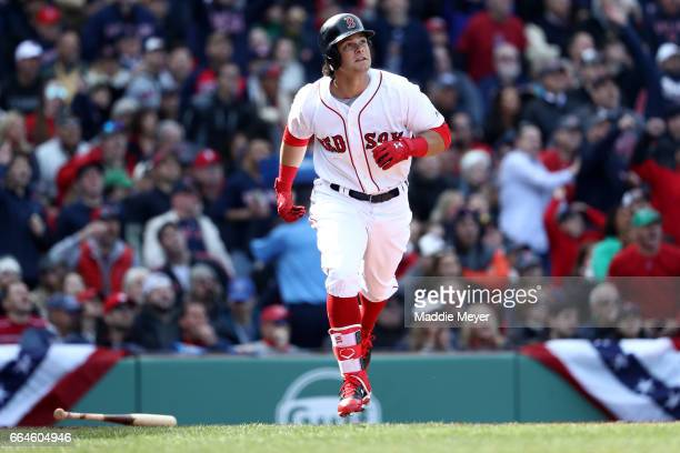 Andrew Benintendi of the Boston Red Sox watches his three run home run during the fifth inning of the opening day game against the Pittsburgh Pirates...