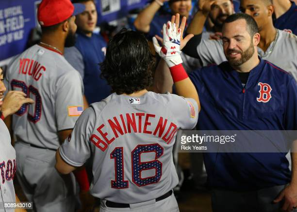 Andrew Benintendi of the Boston Red Soxs celebrates in the dugout after hitting a solo home run in the eighth inning against the Texas Rangers at...