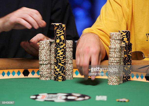 Andrew Black of Ireland and Scott Lazar of California stack their chips as they compete in the sixth round of the World Series of Poker nolimit Texas...