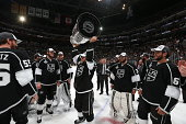 Andrew Bodnarchuk of the Los Angeles Kings celebrates with the Stanley Cup after they won Game Five 32 in double overtime over the New York Rangers...