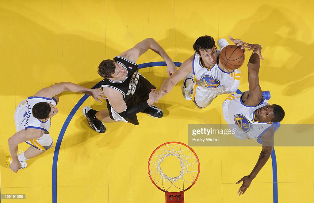 Andrew Bogut #12 and Festus Ezeli #31 of the Golden State Warriors rebound against Tiago Splitter #22 of the San Antonio Spurs in Game Six of the Western Conference Semifinals during the 2013 NBA Playoffs on May 16, 2013 at Oracle Arena in Oakland, California.
