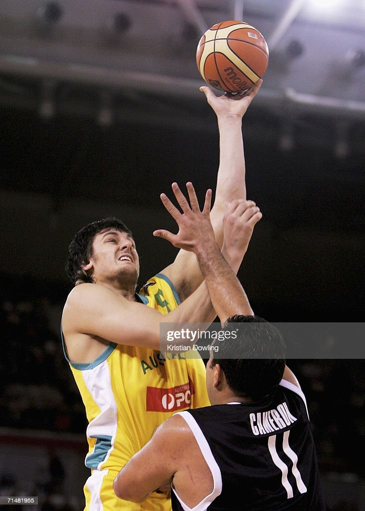 Andrew Bogut of the Boomers shoots over Pero Cameron of the Tall Blacks during the Resi Mortgage Test Series match between the Australian Boomers and the New Zealand Tall Blacks at Vodafone Arena July 19, 2006 in Melbourne, Australia.