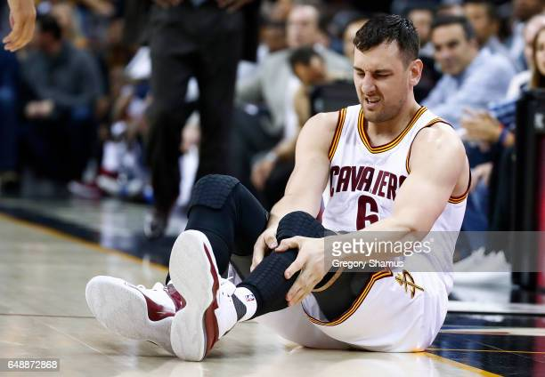Andrew Bogut of the Cleveland Cavaliers reacts after getting hurt in the first half while playing the Miami Heat at Quicken Loans Arena on March 6...