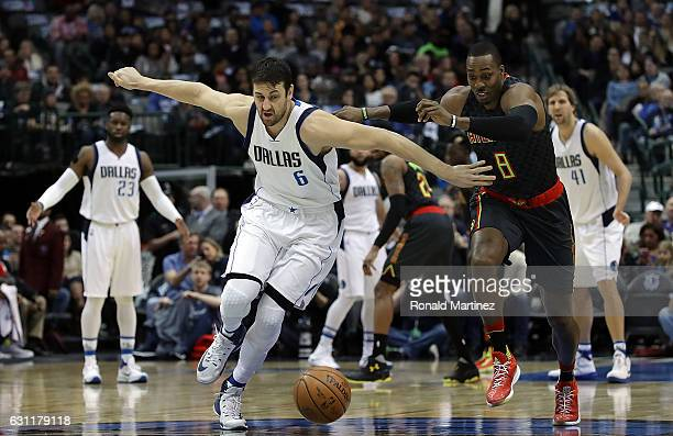 Andrew Bogut of the Dallas Mavericks runs for the loose ball against Dwight Howard of the Atlanta Hawks at American Airlines Center on January 7 2017...