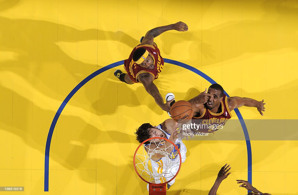 <a gi-track='captionPersonalityLinkClicked' href=/galleries/search?phrase=Andrew+Bogut&family=editorial&specificpeople=207105 ng-click='$event.stopPropagation()'>Andrew Bogut</a> #12 of the Golden State Warriors and <a gi-track='captionPersonalityLinkClicked' href=/galleries/search?phrase=Samardo+Samuels&family=editorial&specificpeople=5042441 ng-click='$event.stopPropagation()'>Samardo Samuels</a> #24 of the Cleveland Cavaliers battle for the rebound on November 7, 2012 at Oracle Arena in Oakland, California.
