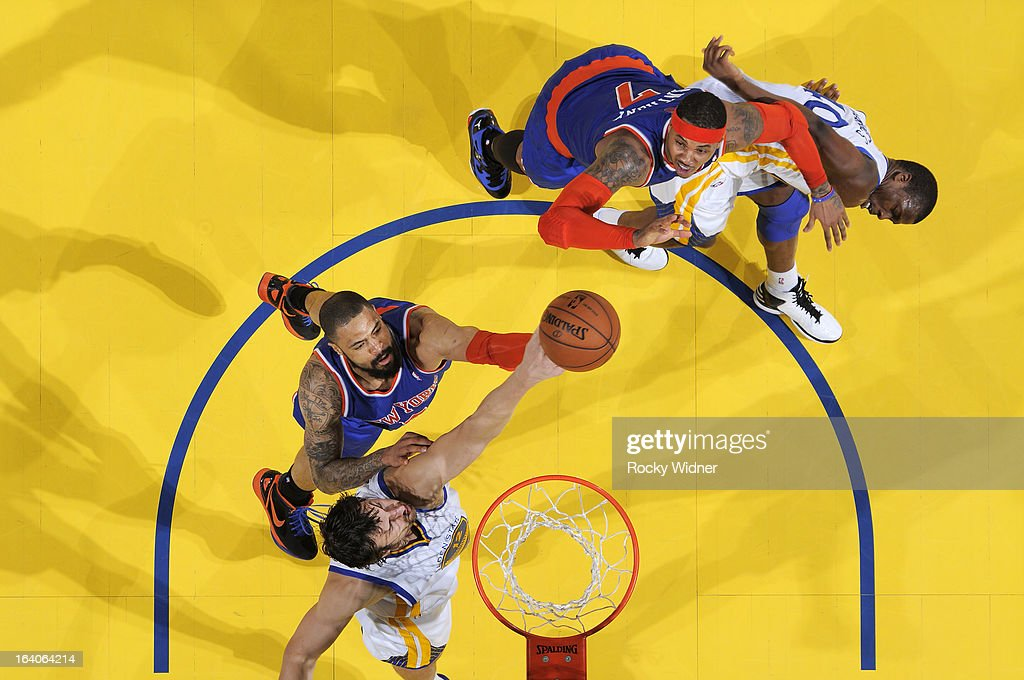 <a gi-track='captionPersonalityLinkClicked' href=/galleries/search?phrase=Andrew+Bogut&family=editorial&specificpeople=207105 ng-click='$event.stopPropagation()'>Andrew Bogut</a> #12 of the Golden State Warriors battles with <a gi-track='captionPersonalityLinkClicked' href=/galleries/search?phrase=Tyson+Chandler&family=editorial&specificpeople=202061 ng-click='$event.stopPropagation()'>Tyson Chandler</a> #6 of the New York Knicks for the rebound on March 11, 2013 at Oracle Arena in Oakland, California.